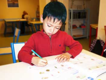 a child working on a grammar exercise